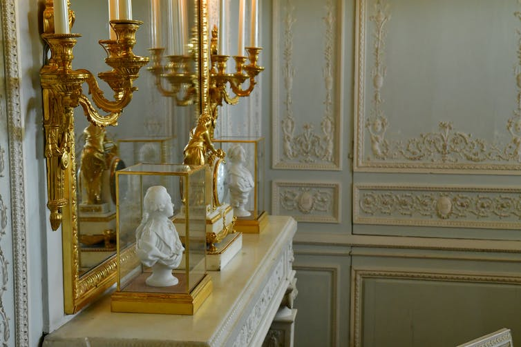gold mirror and candles