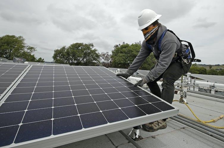 Person installing solar panel