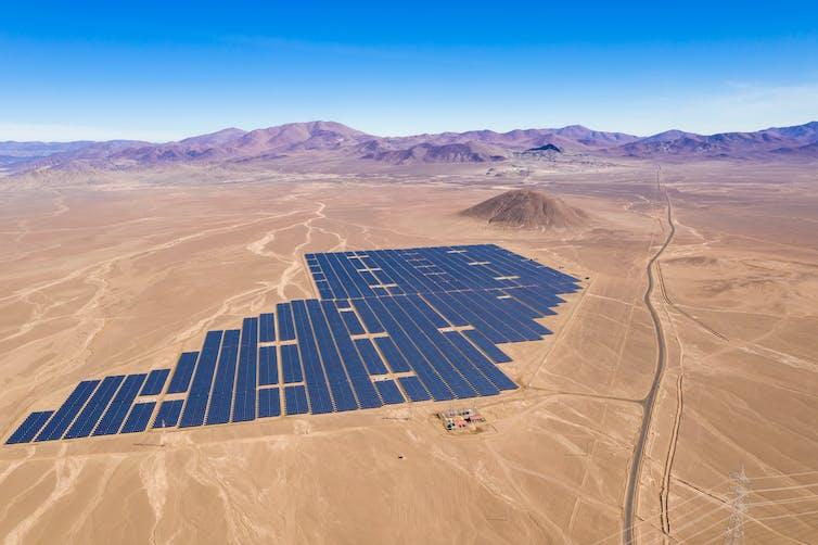 Aerial view of solar panels in the desert