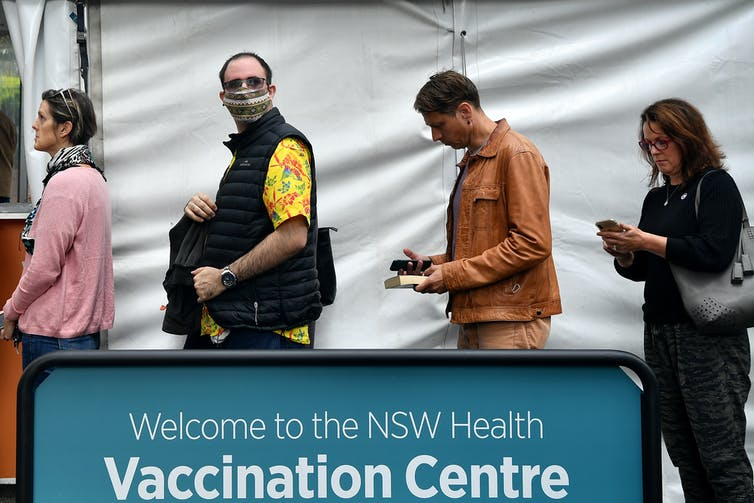 People lining up for vaccination.