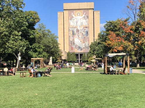 Students outdoors on University of Notre Dame campus