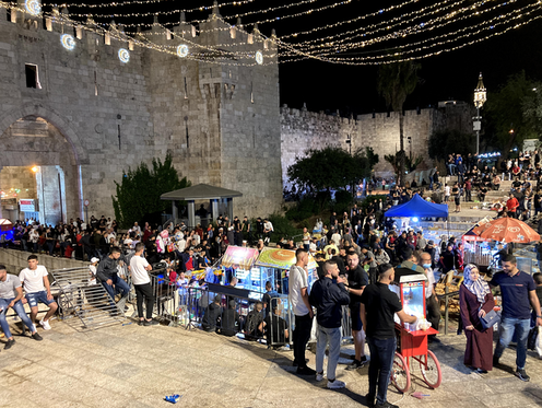 Crowds of young Palestinians celebrate Ramadan breakfast at Jerusalem's Damascus Gate, May 2021.