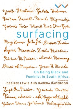 A book cover for 'Surfacing' with the names of the contributors written out in ink pen italics across the surface of the book.