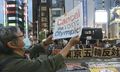 A protester objects to plans to hold the Tokyo Olympics.