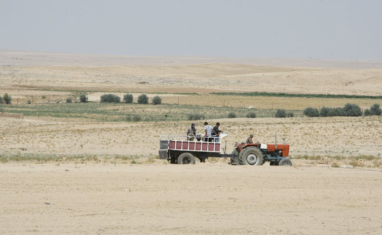 Dry, empty landscape with a tractor