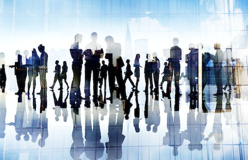 Graphic of silhouettes of people in a work place.