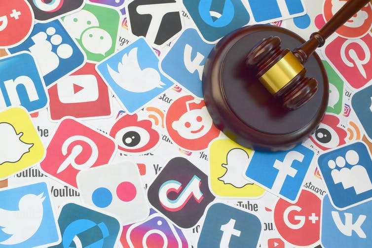 Social media logos like TikTok, Twitter, Reddit, Facebook, Instagram, Tumblr are in a collage with a judges gavel on top