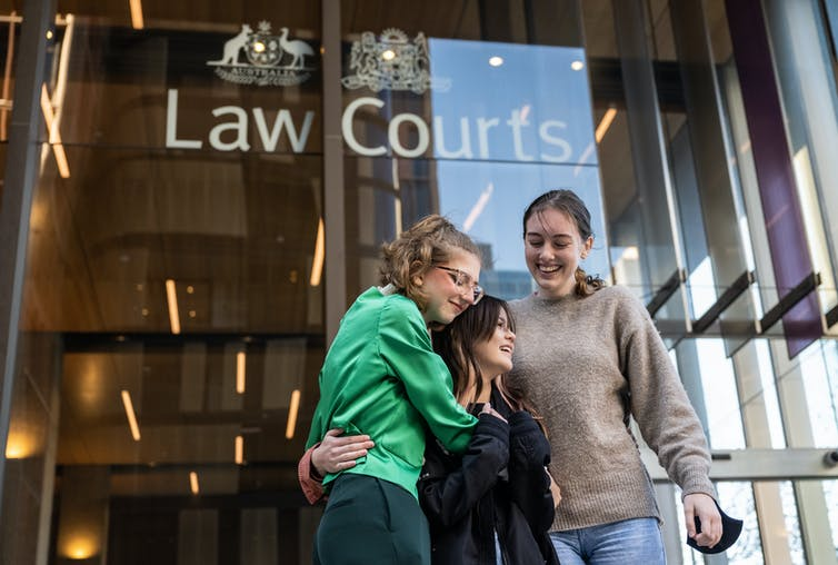 Three teens involved in the case embrace outside the Federal Court