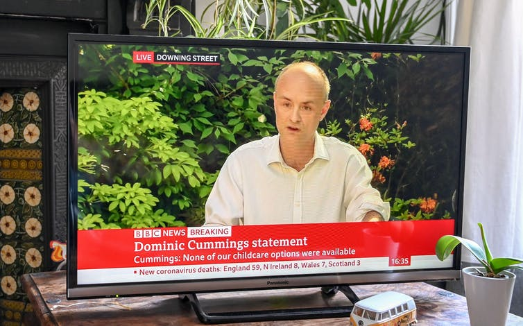 A TV screen showing Dominic Cummings giving a statement in 2020.