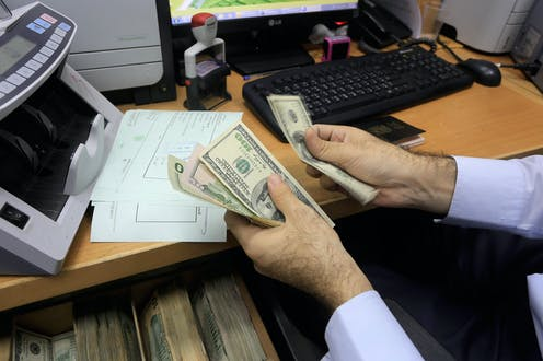 A man counting dollar bills.