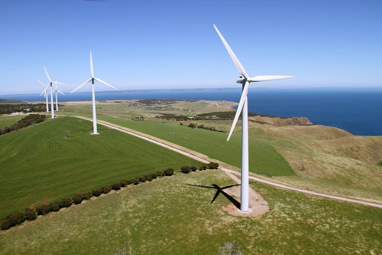Wind turbines over farm