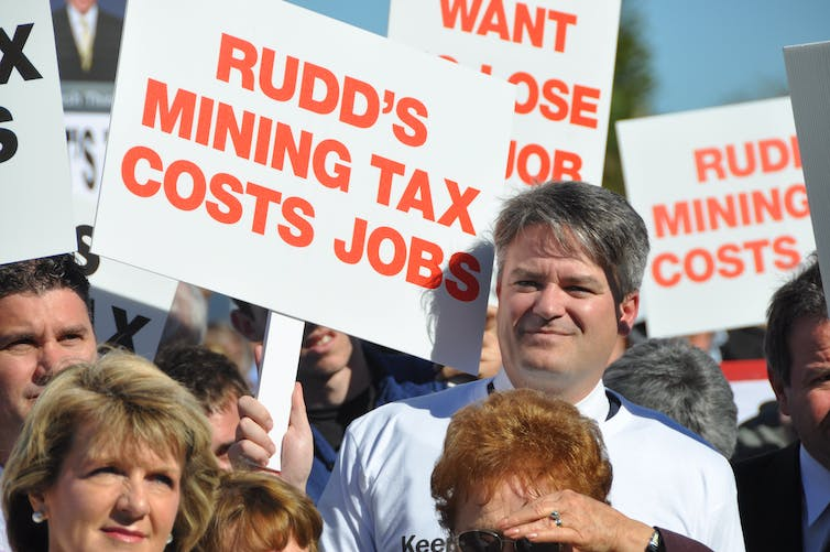 Then WA Liberal senator Mathias Cormann and deputy federal Liberal leader Julie Bishop join protesters in Perth opposing the Rudd government's proposed mining super profit tax in June 2010.