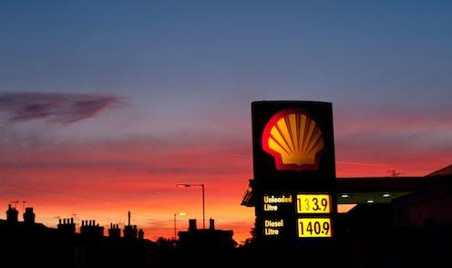 Shell petrol station sign against sunset sky
