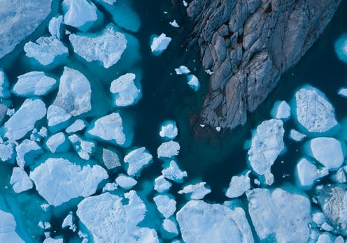 Drone aerial image of icebergs from a melting glacier in an icefjord in Greenland