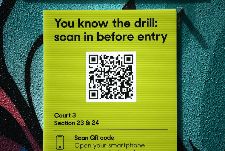 A sign showing a QR code is displayed.