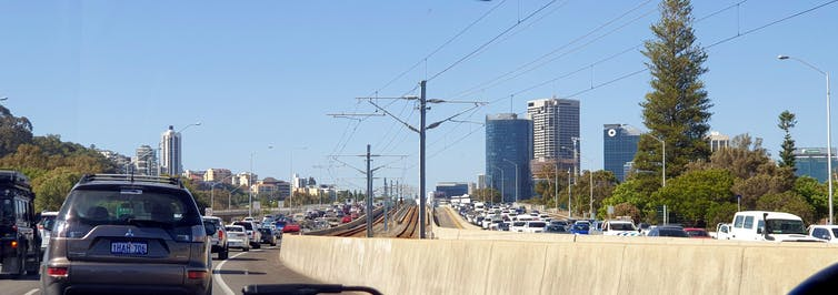 Late afternoon congestion in both directions on the Kwinana Freeway (looking north towards and onto the Narrows Bridge) in Perth, Western Australia