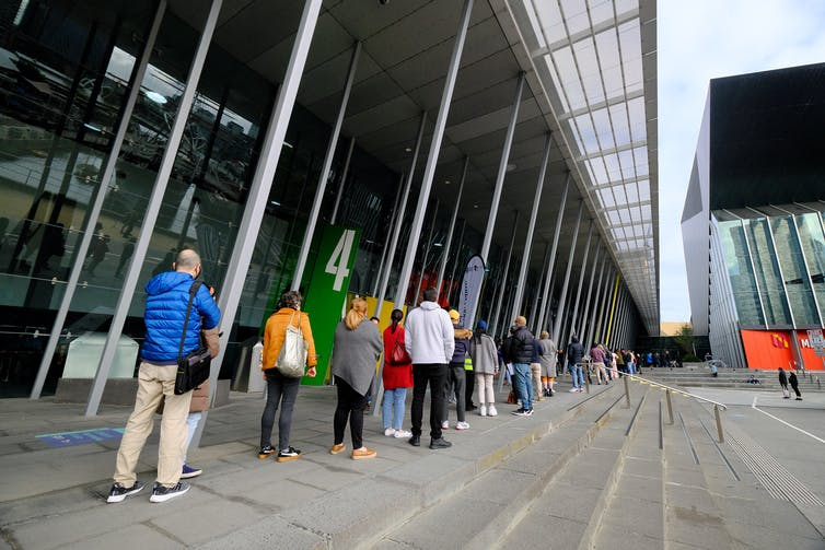 People line up for vaccinations outside the Melbourne Convention and Exhibition Centre.
