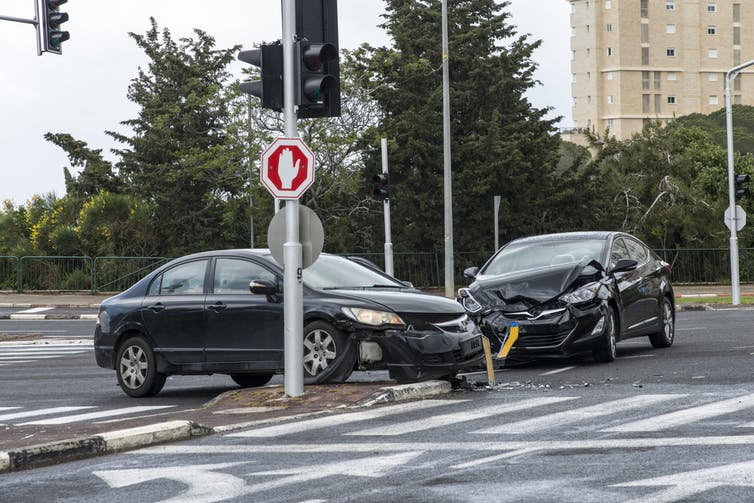 Two cars in an intersection after colliding.