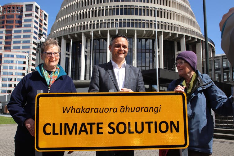 Climate change minister James Shaw and supporters outside parliament