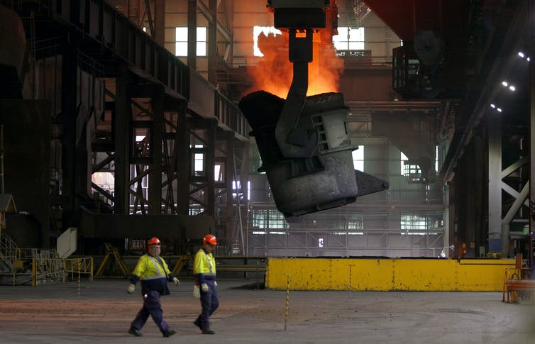 Steel workers at plant