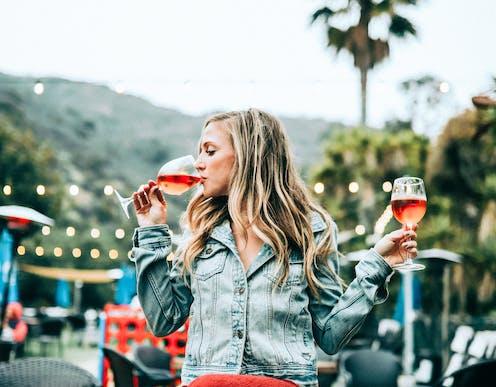 A women drinks wine outside