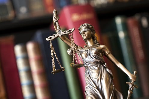 A figurine of Lady Justice.
