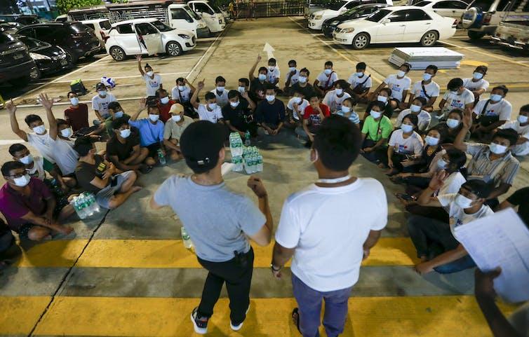 Health volunteers in Myanmar being briefed
