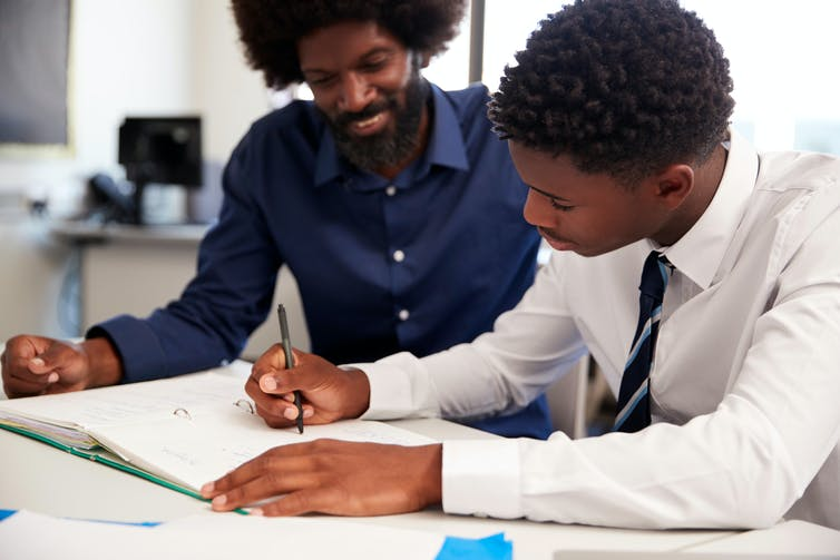 A secondary school pupil does a lesson with a tutor