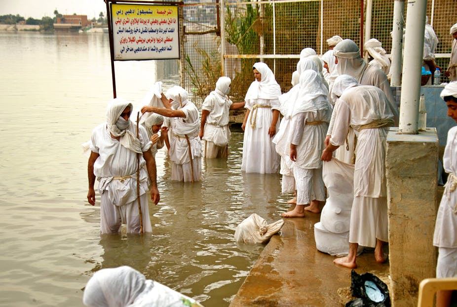 """Followers of the Sabean Mandaeans faith, a pre-Christian sect that follows the teachings of the Bible's John the Baptist, perform their rituals in the Tigris River during a celebration marking """"Banja"""" or Creation Feast, in central Baghdad, Iraq, Monday, March 15, 2021."""