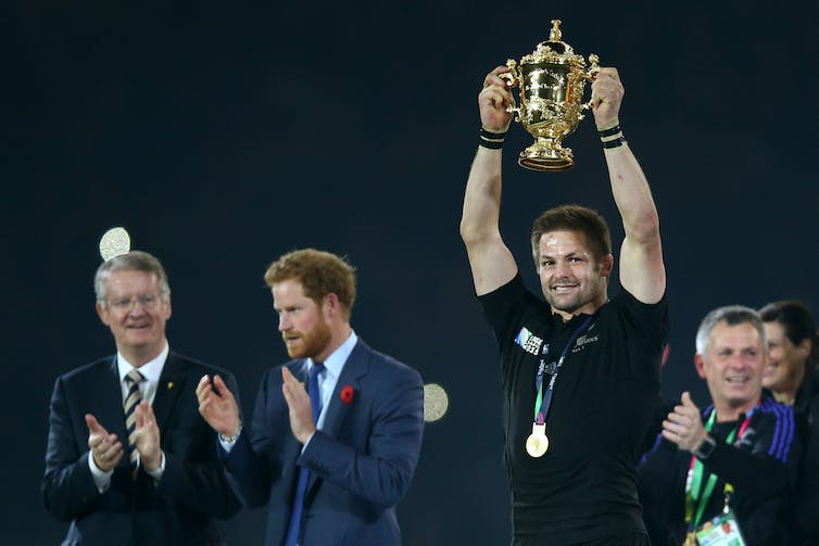 Richie McCaw lifts the Webb Ellis cup at the Rugby World Cup Final in London