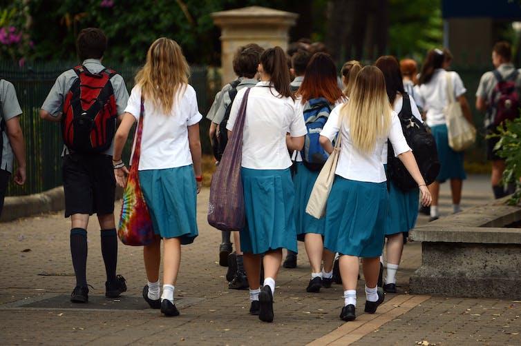 school students walking along a path
