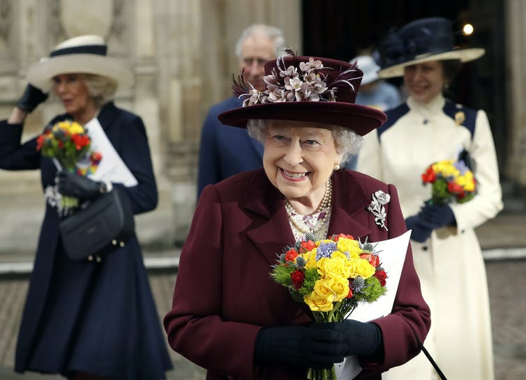 The queen leaves Westminster Abbey, followed by Camilla, Prince Charles and Princess Anne.