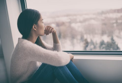 A woman looking out of the window
