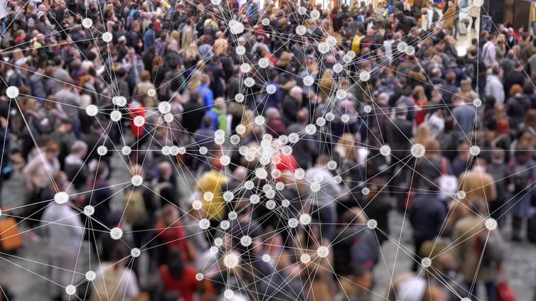 Crowd of people overlaid by a computer web