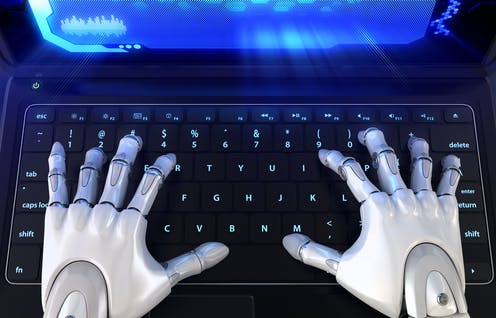 human-like robot hands on a laptop keyboard