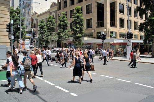 pedestrians crossing city streets