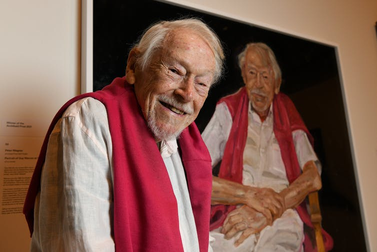 older man with portrait of him