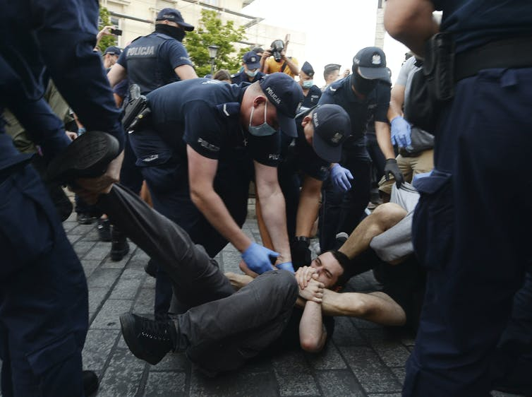 Police scuffle with LGBTQ protesters in Poland.