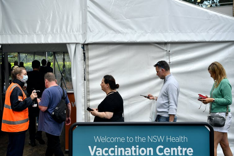 People line up for vaccination at a Sydney hub.