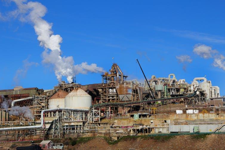 Industrial plant billowing smoke