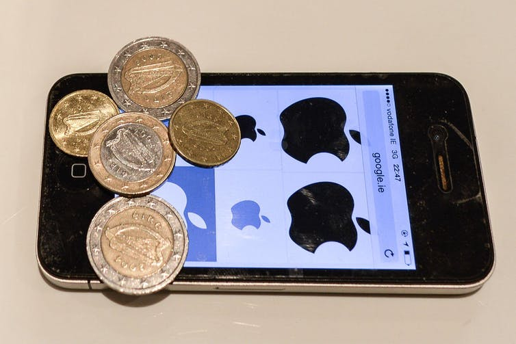 An iPhone with some euro coins on top of it