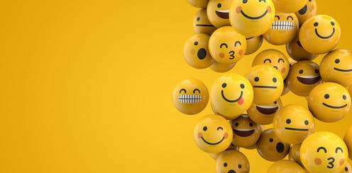 A group of emojis floating in the air.