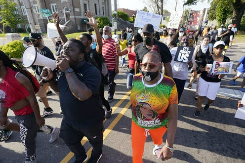 A group of people protesting the police shooting of Andrew Brown Jr., marching  along South Road in Elizabeth City, North Carolina.