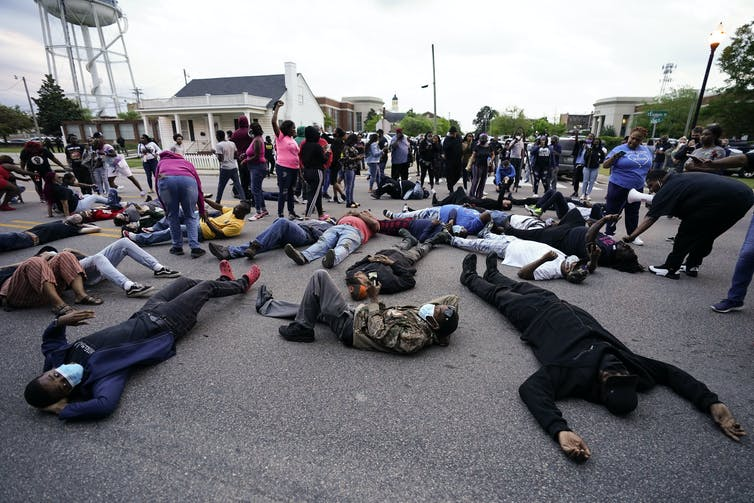 Protesters lying on the ground near the county sheriff's office and the Camden Causeway Bridge in Elizabeth City.