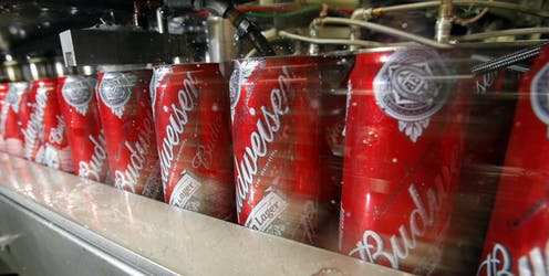 Budweiser cans on a factory line.