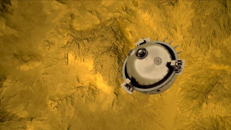 A circular probe with sampling equipment on it falling towards Venus.