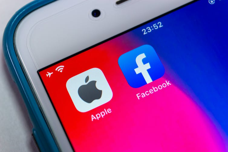 phone showing Apple and Facebook apps