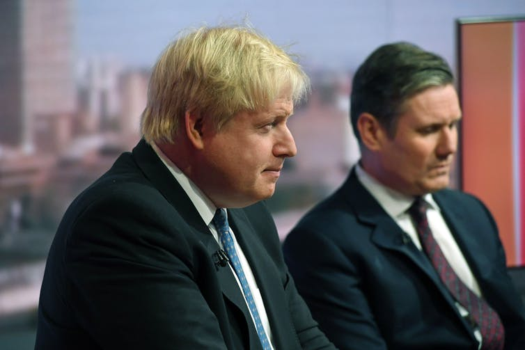 Boris Johnson and Keir Starmer sat next to each other in a TV studio