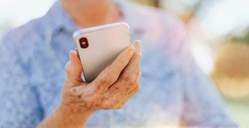 Smartphone held in woman's hand.