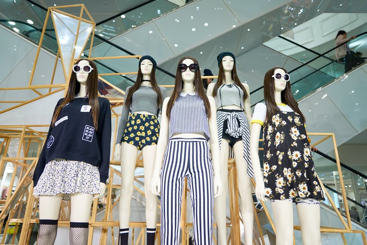 Five mannequins in fashionable clothing